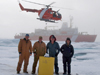 WHOI researchers and engineers pose next to float of an ice-tethered profiler they just deployed in the Beaufort Sea