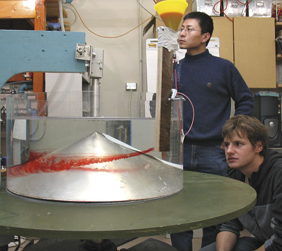 Graduate students Jinbo Wang (left) and Evgeny Logvinov.