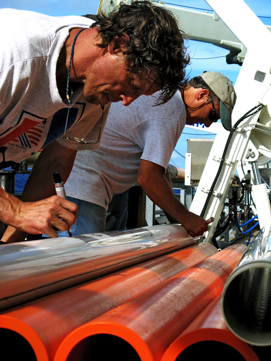 Terry Hammar and Al Gagnon labeling cores recovered with the Long Core.