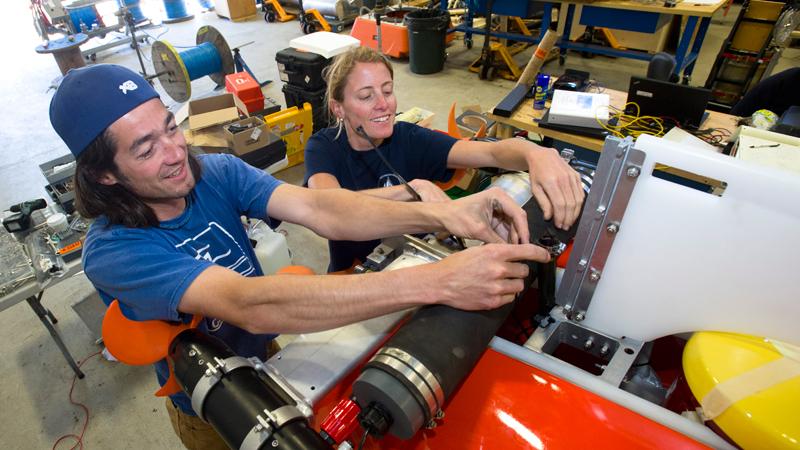 Tom Lanagan and Loral O'Hara working on Nereid UI vehicle.