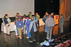 image of audience approaching exhibit table