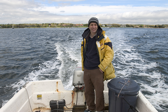 WHOI Marine mammal biologist and veterinarian Michael Moore has developed numerous techniques for working with whales from small open boats, including mechanisms for delivering medicines to whales.