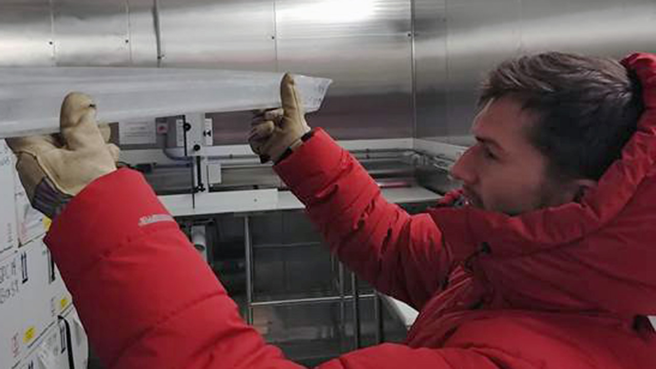 Matt Osman holds ice core