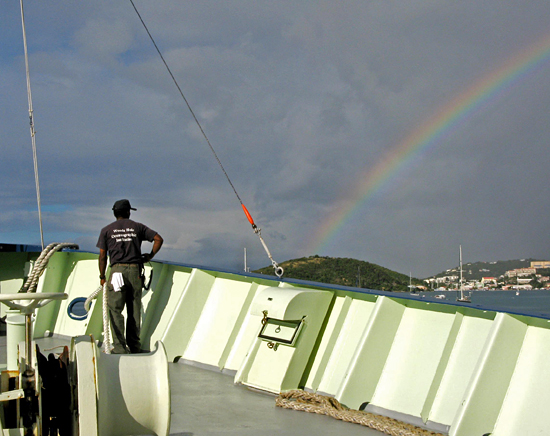 Bosun Clindor Cacho admires a rainbow as the Oceanus prepares to dock at St. Thomas