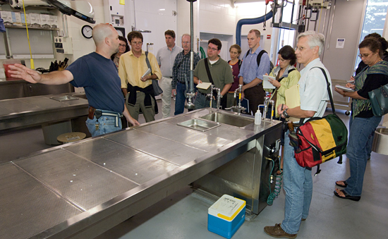 Scott Cramer showing the Ocean Science Journalism Fellows the MRF facility.