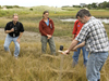 Jeff Donnelly gives coring demonstration at Woodneck beach to the 2006 Ocean Science Journalism Fellows.