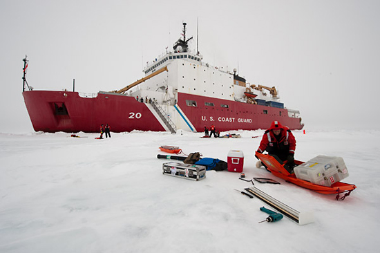 scientist preparing gear on ice