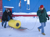 Kris Newhall and John Toole toting the ITP on a sled through the snow.