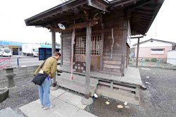 "Ken Buesseler pays his respects in front of Namiwake Jinja. The shrine was originally built on land that was spared during the Jogan tsunami of 869 A.D. Namiwake roughly translates as ""split wave."""