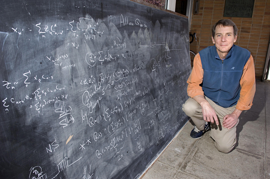Gene Terray with uncovered blackboard.