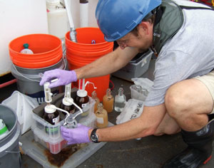 WHOI chemist Ben Van Mooy adds chemical reagents to water samples in preparation for an oxygen assay called the Winkler titration.