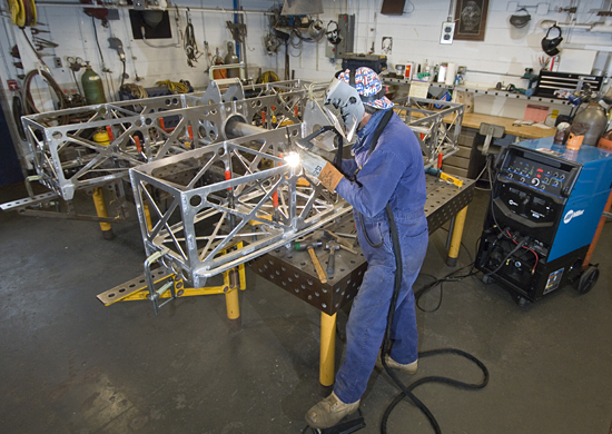 Lead Welder Geoffery Ekblaw working on the assembly of the HROV (Nereus) frame in the welding shop.