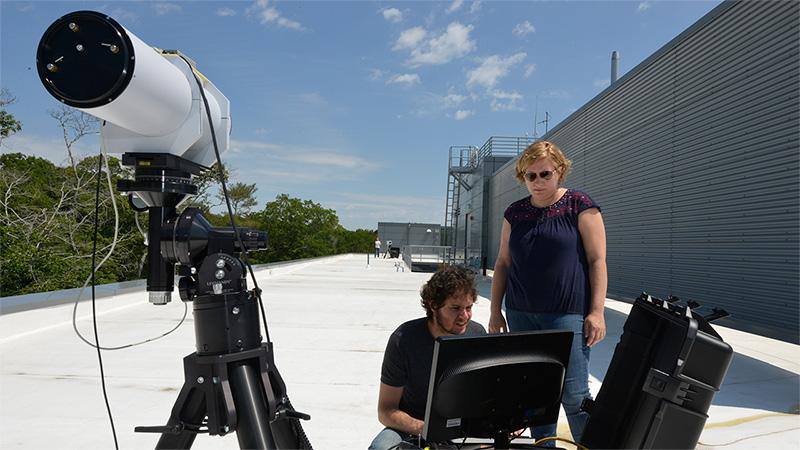 Anna Michel and Jason Kapit test laser spectrometer