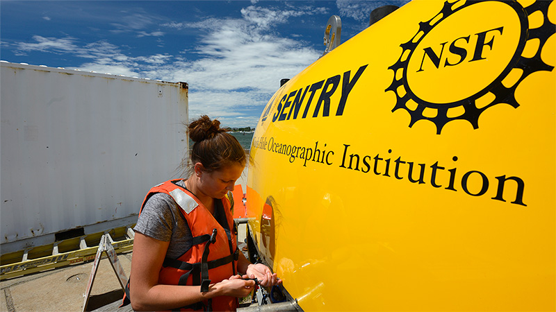 WHOI engineer Molly Curran works on the autonomous underwater vehicle Sentry.