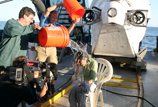 Seewald and Sievert dousing Ann Curry with water