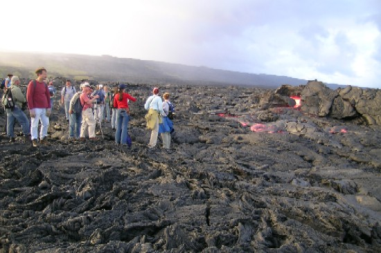 We had the wonderful opportunity to see flowing lava up close. Here we are watching a tumulus that has broken open revealing the 1200 deg C, incandescent