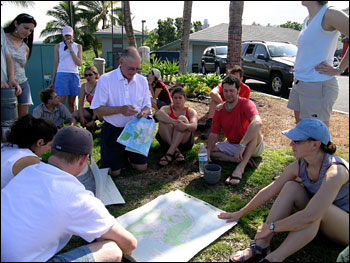 The group consults maps before setting out for the Kaupulehu flow.