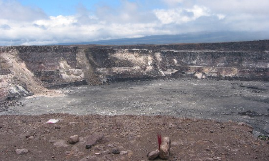 Halemaumau Crater, shown here, sits within the larger Kilauea Caldera. It is the site of the most recent eruptive activity at the summit of Kilauea Volcano. In the foreground you can see offerings left to the volcano goddess Pele.