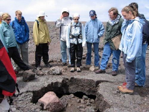 The group was led on a tour of explosive eruption deposits from Kilauea Volcano by Don Swanson, scientist-in-charge at the Hawaiian Volcanoes Observatory. Here, Don shows us a boulder ejected during the 1880 (?) eruption that has us transfixed.