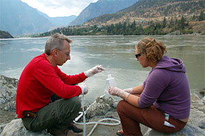 collecting water samples from the Fraser River