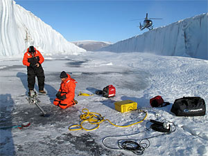 Fiamma Straneo and Jim Ryder deploying instruments through the ice