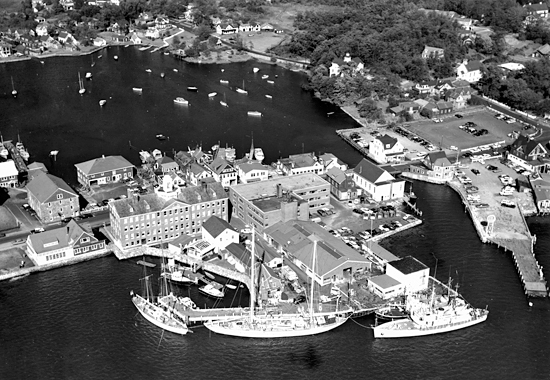 Aerial view of R/V's Aries, Atlantis, Crawford, and Bear at WHOI dock.