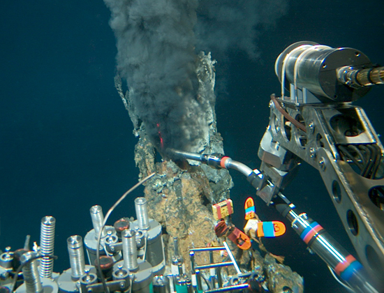 Black smoker being sampled on Alvin dive 3764, January 30, 2002.