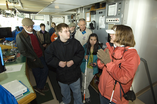 Amy Bower showing Perkins School students around the Pilot House of Knorr.