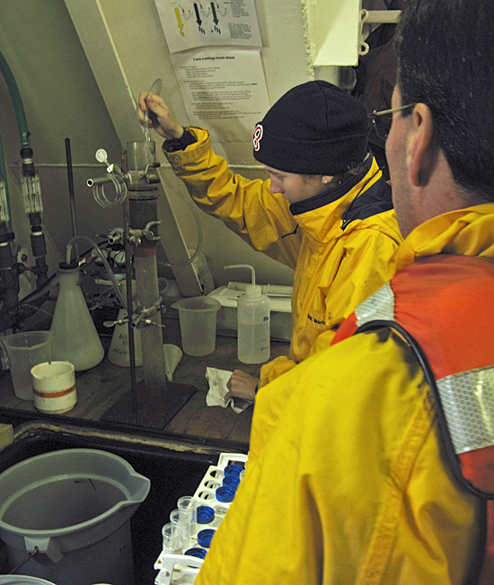 Bryn Warren and Luciano Fernandes process mud samples for Red Tide Cysts in Oceanus wet lab.