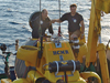 WHOI scientist Richard Camilli shakes hands with pilot Konstantinos