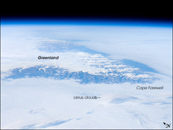 View of Cape Farewell from space, taken by astronauts on the international space station. The ice cap, some 3,000 meters high, is surrounded by rugged mountains cut by many fjords.
