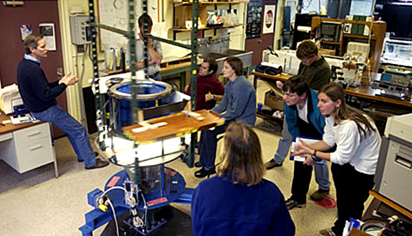 Dave explaining the dynamics of a laboratory demonstration to graduate students