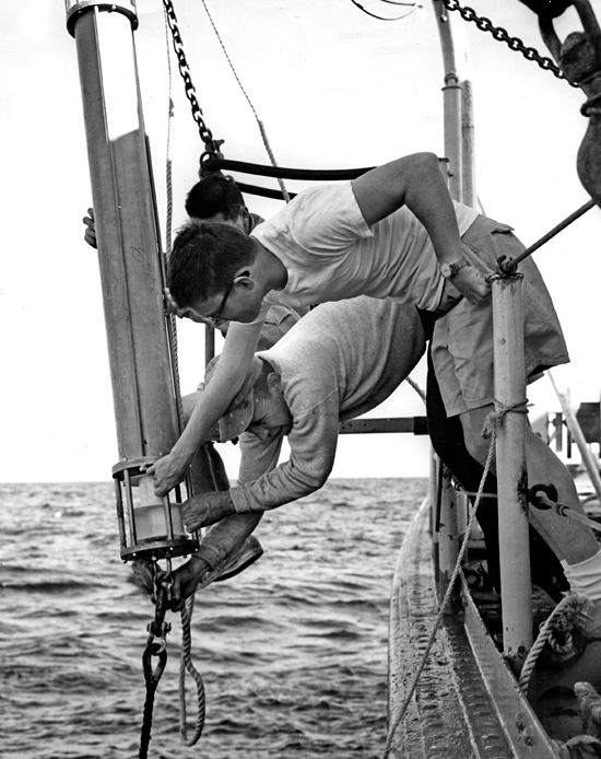 Gus Day (bottom) and Marvel Stalcup (glasses) working on the R/V Crawford.
