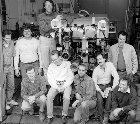 Engineers and students from the WHOI Deep Submergence Laboratory gather around the first full-scale Jason