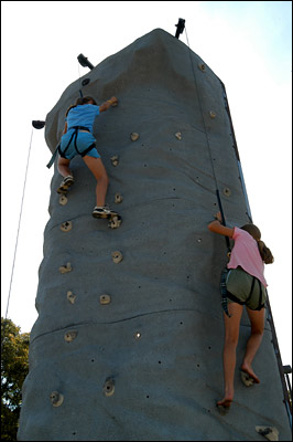Children climbing the rock wall at the summer picnic