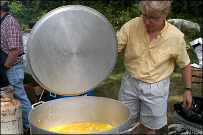 Ellen Bailey with a big pot of corn