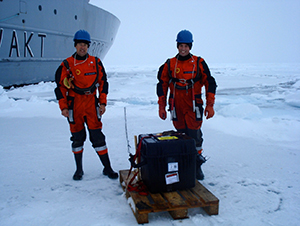 Lee Freitag and Peter Koski on the ice in the Fram Strait with an acoustic recorder.