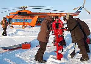 John Kemp (in red jacket) directing deployment operations at Camp Barneo in the Arctic