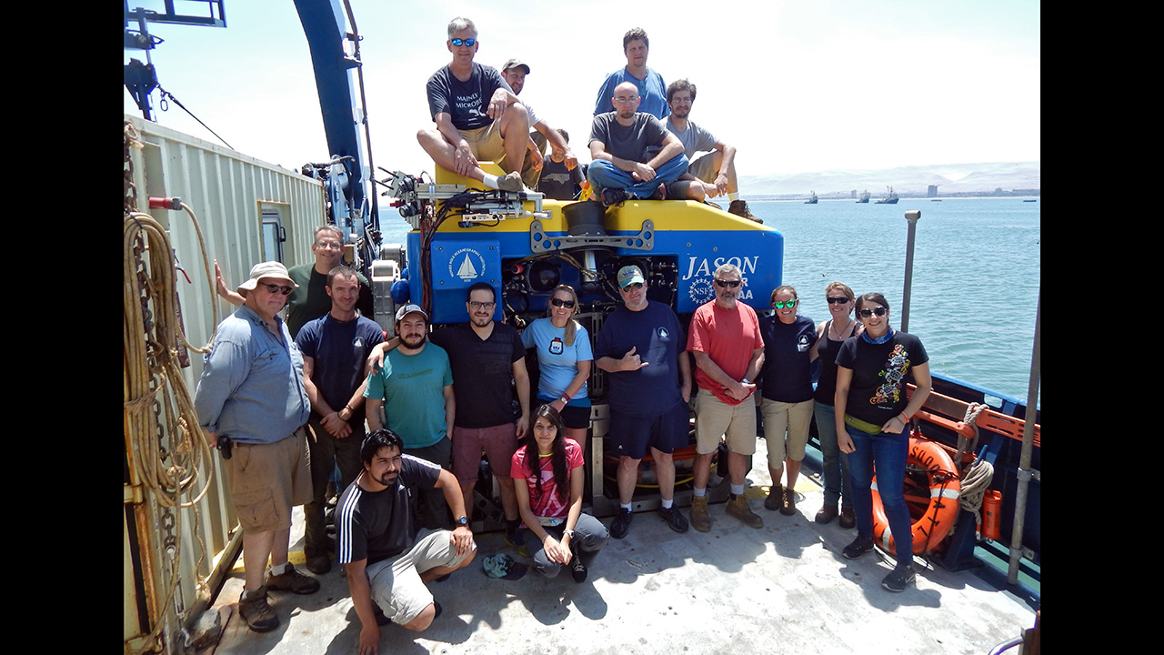 crew pose ontop of and next to ROV Jason
