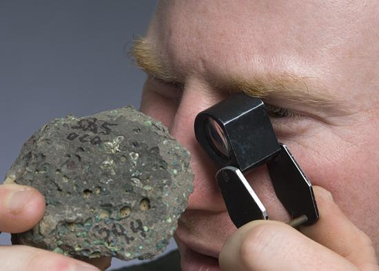 adam soule examining rock