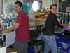 Tim Shanahan and Kim Popendorf working in the main lab of Oceanus.