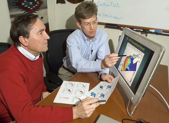 Don Anderson and Dennis McGillicuddy reviewing HAB model data.