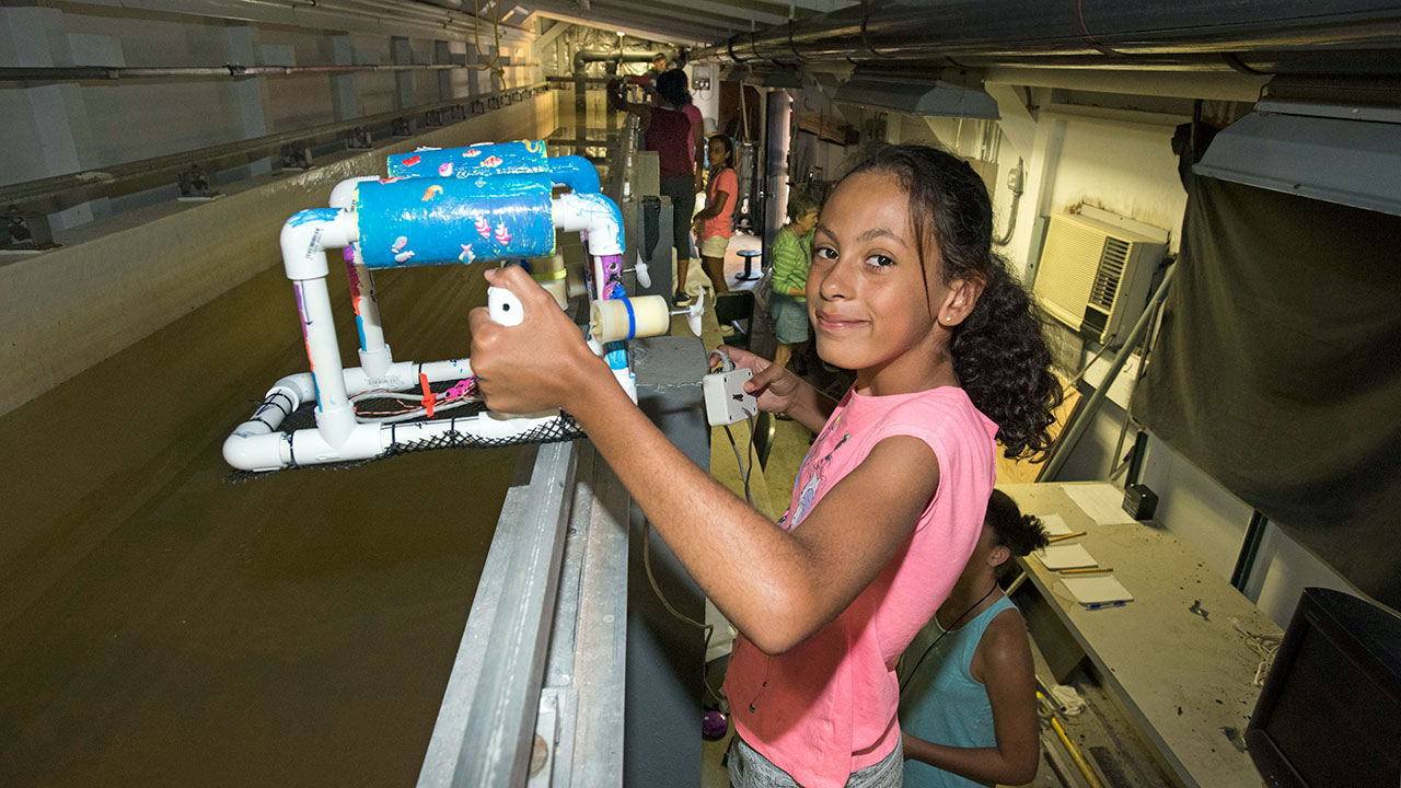 Girl with remotely operated vehicle