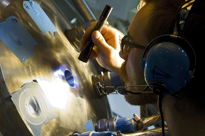 Jefferson Grau inspects penetrator hole on new Alvin