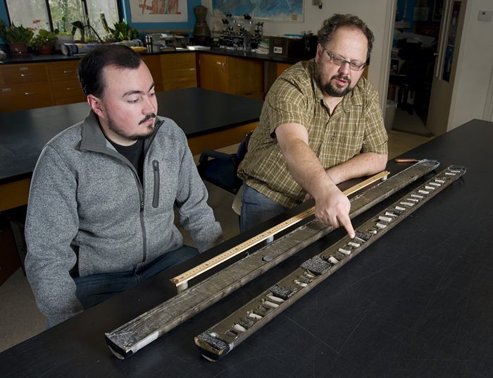 Camilo Ponton and Liviu Giosan examine a sediment core from India
