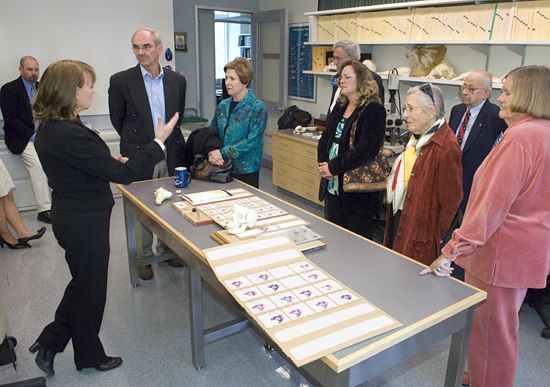 Darlene Ketten (at left) showing trustee tour group the WHOI CSI.