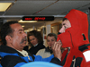 R/V Oceanus first mate Diego Mello (left) helps WHOI Postdoc Tim Shanahan get into his 'Gumby' suit.
