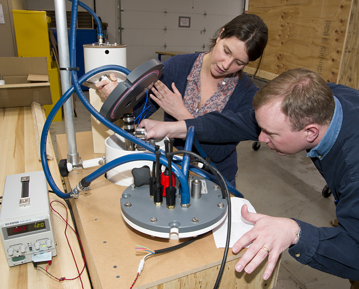 Kate McMonagle and John Lund work on a carbon dioxide sensor