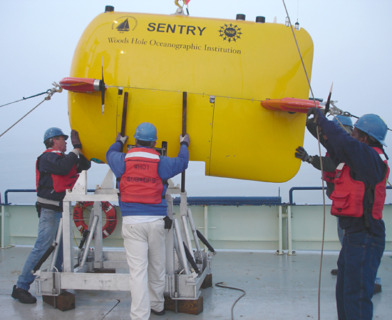 Al Duester, center, coordinating the recovery operations of AUV Sentry.