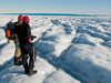 Sarah Das and Ian Joughin view supraglacial lake on Greenland ice sheet